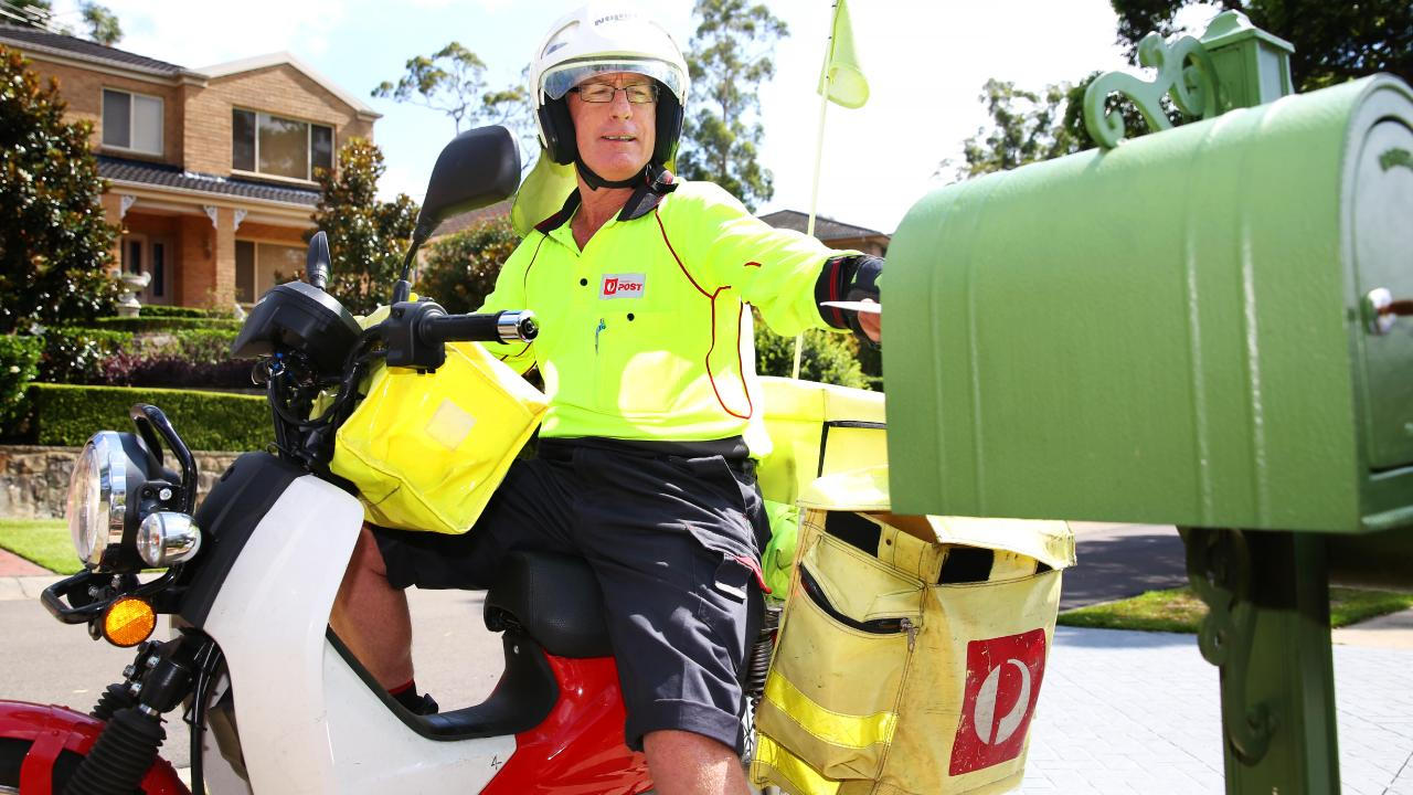 This postie is delivering the mail. Many customers are angry that too often their parcels are not delivered and a card left instead directing them to the Post Office. Picture: AAP Image / Angelo Velardo.
