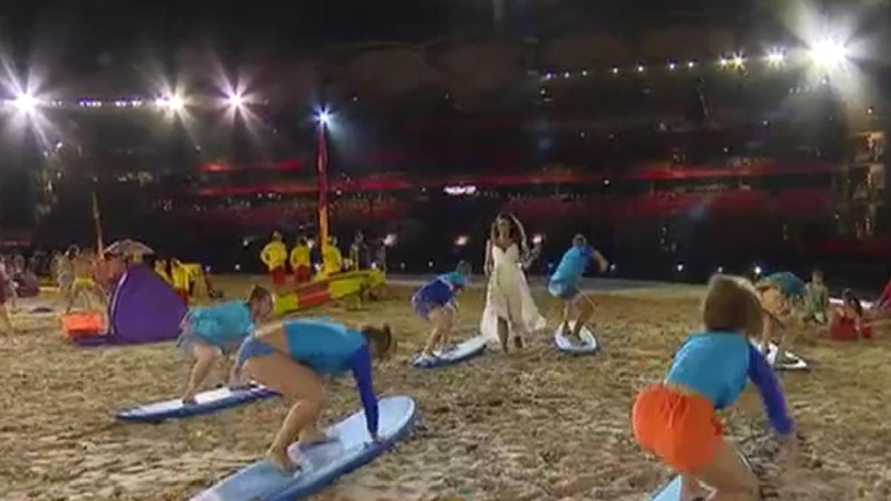 Ricki-Lee Coulter performs with a group of surf lifesavers at the dress rehearsal. Picture: Channel 7