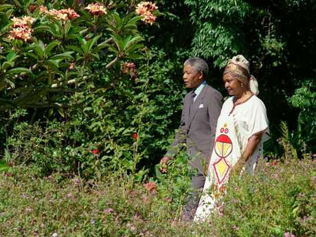 Nelson and Winne in the garden of Archbishop Desmond Tutu's residence in Cape Town, one day after his release from jail. Picture: AFP PHOTO / WALTER DHLADHLA
