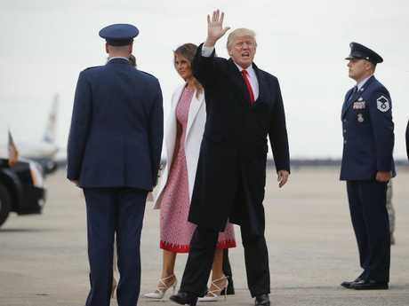 The President waves to the media as he arrives at Andrews Air Force Base on Sunday with wife Melania and their son Barron to return to the White House after spending Easter weekend at his Mar-a-Lago estate. Picture: AP Photo/Pablo Martinez Monsivais