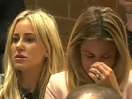 Roxy Jacenko comforts Candice Warner at her husband's press conference.