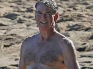 Pierce Brosnan flaunts beach bod
