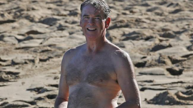 Pierce Brosnan shows off his James Bond bod at 61.