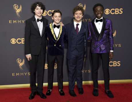 Stranger Things stars Finn Wolfhard, from left, Noah Schnapp, Gaten Matarazzo, and Caleb McLaughlin arrive at the 69th Primetime Emmy Awards on Sunday, Sept. 17, 2017, at the Microsoft Theater in Los Angeles.