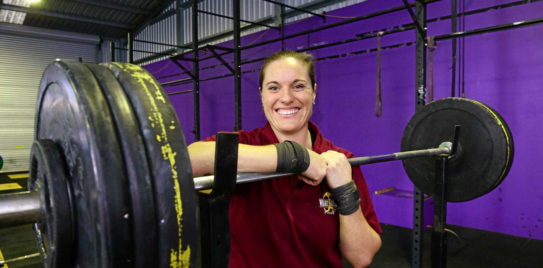 Experienced Ipswich weightlifter Deb Acason is being motivated by her family and past successes at her fifth Commonwealth Games.
