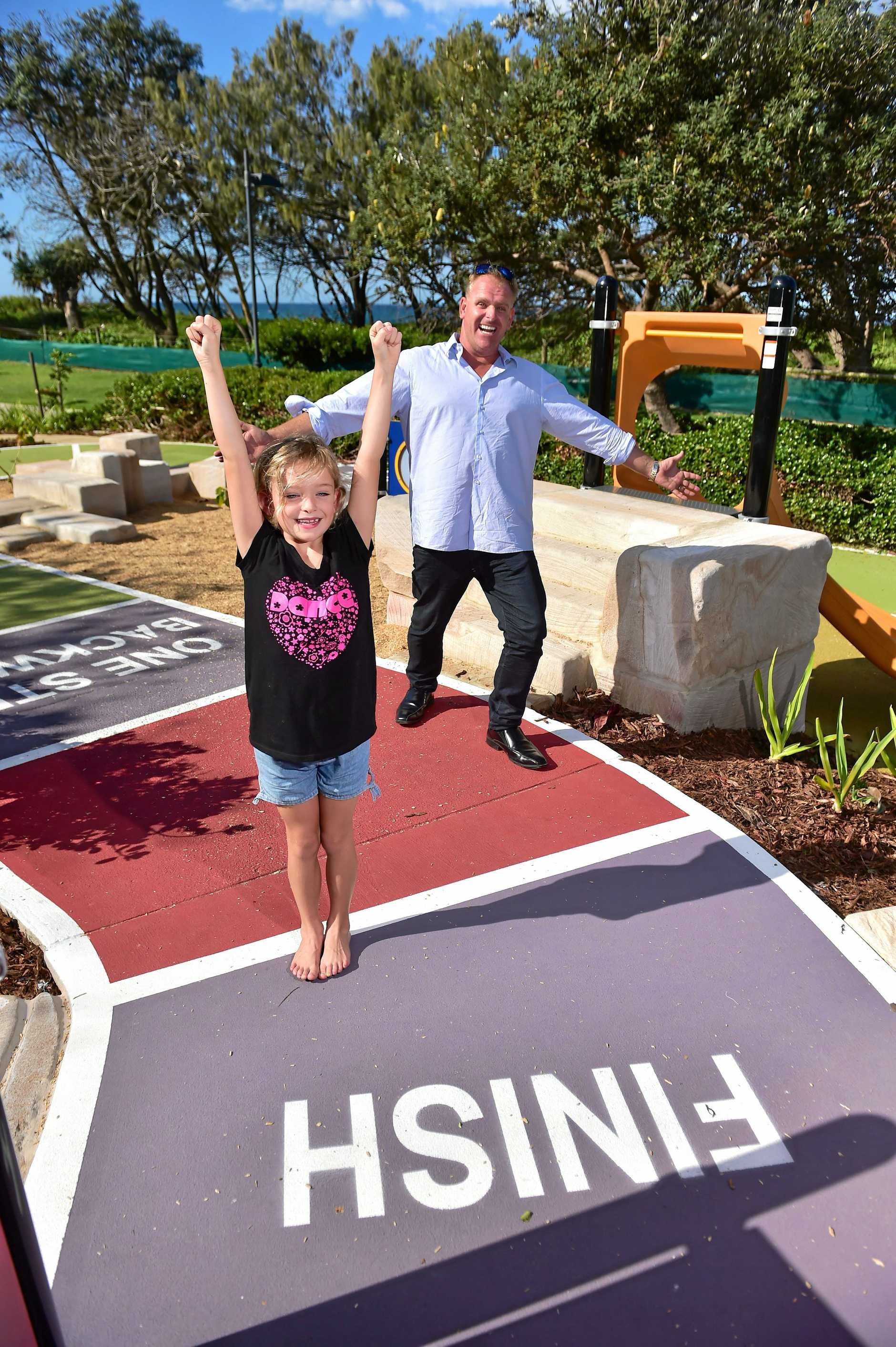 Councillor Jason Opray and his duaghter Jay Jay, 7, at the snakes and ladders playground in the park.