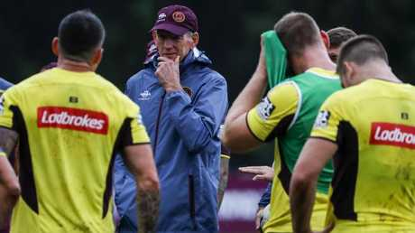 Wayne Bennett (centre) talks to Broncos players at training. Photo: AAP