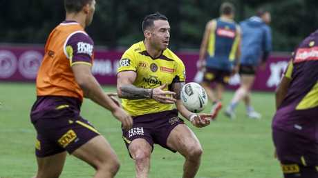 Darius Boyd (centre) in action during Broncos training.