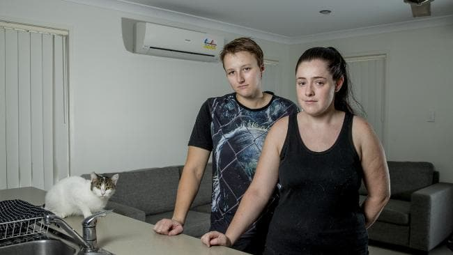 Sarah Spiller and her partner Courtney Buchanan had their three cats killed, they don't know the people who did it, but they broke in, killed the cats and lined them up perfectly in the house. Sarah and Courtney with their sole surviving cat Trixie. Picture: Jerad Williams