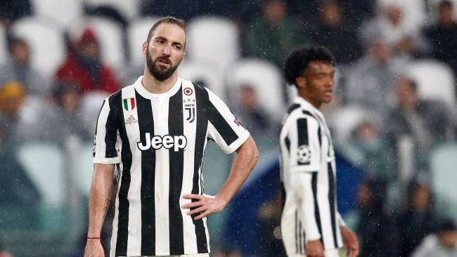 Juventus' forward from Argentina Gonzalo Higuain reacts