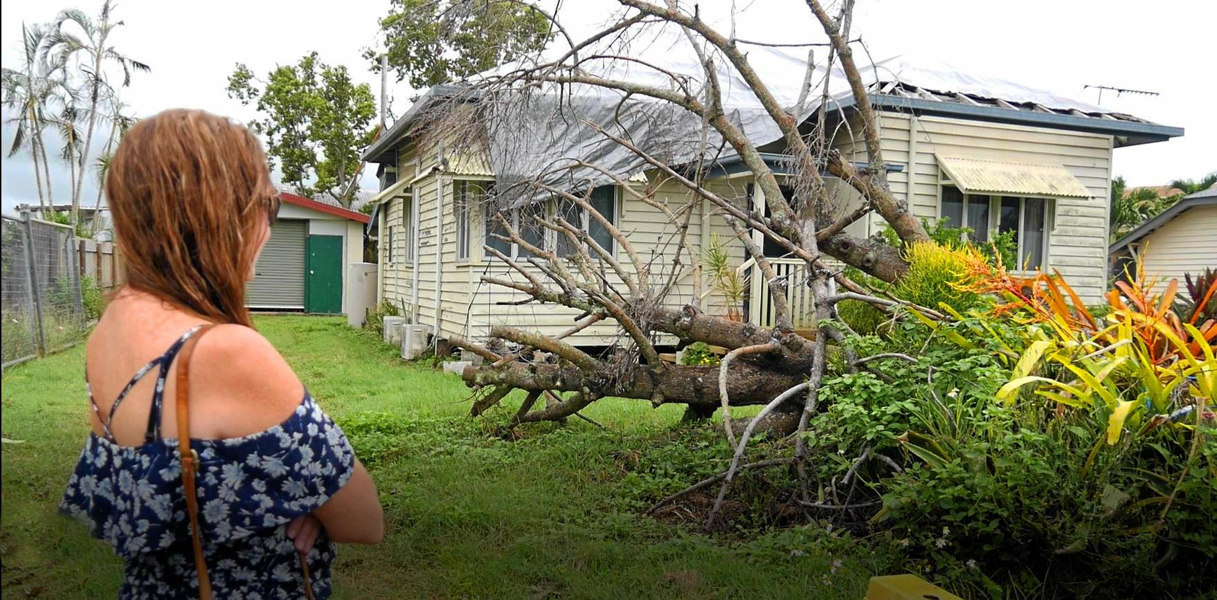 Home owner Mel Deacon surveys the damage to her Proserpine home one year on from Cyclone Debbie.
