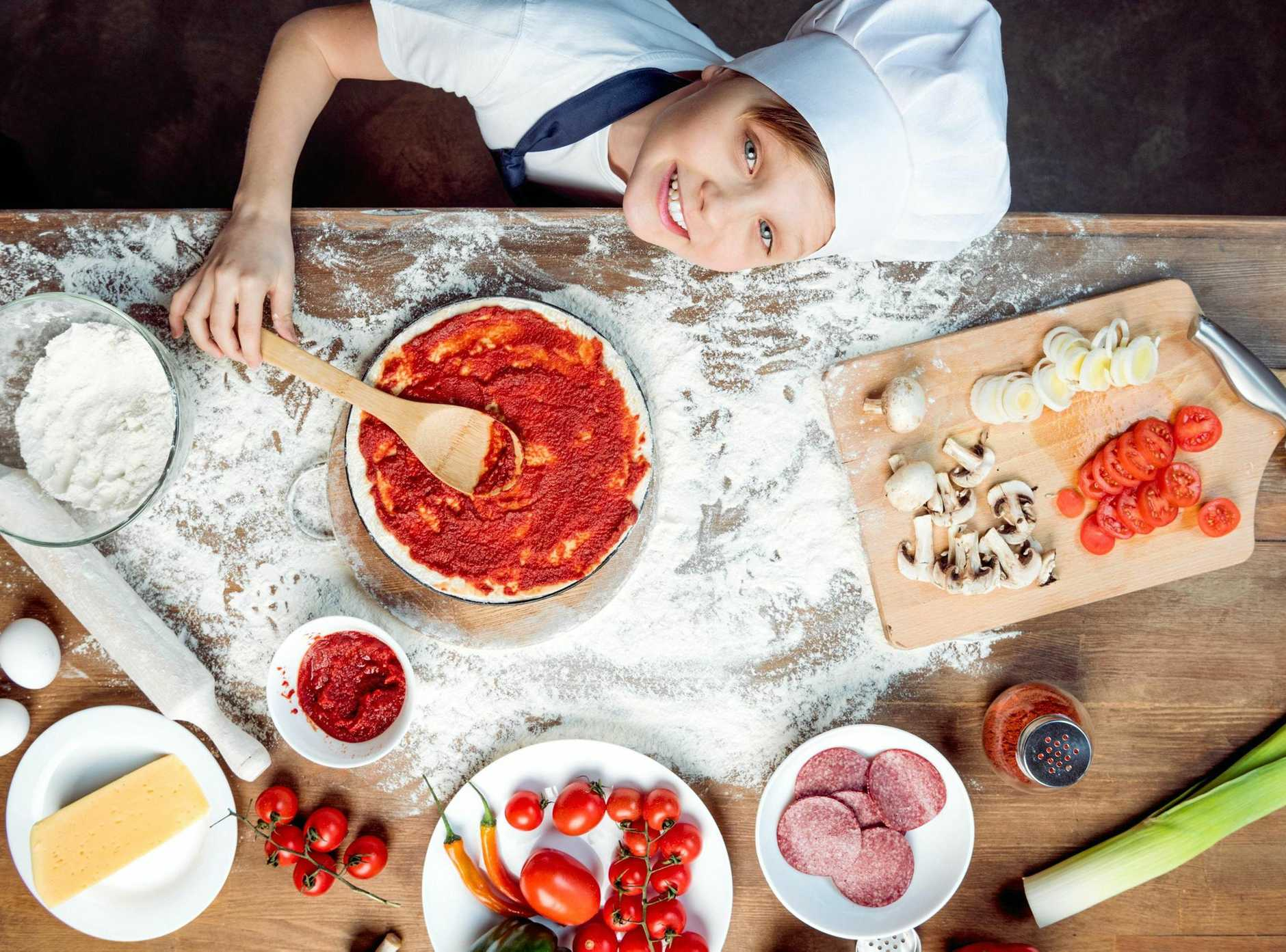 Having a pizza-making competition is a fun activity for the kids during the school holidays.