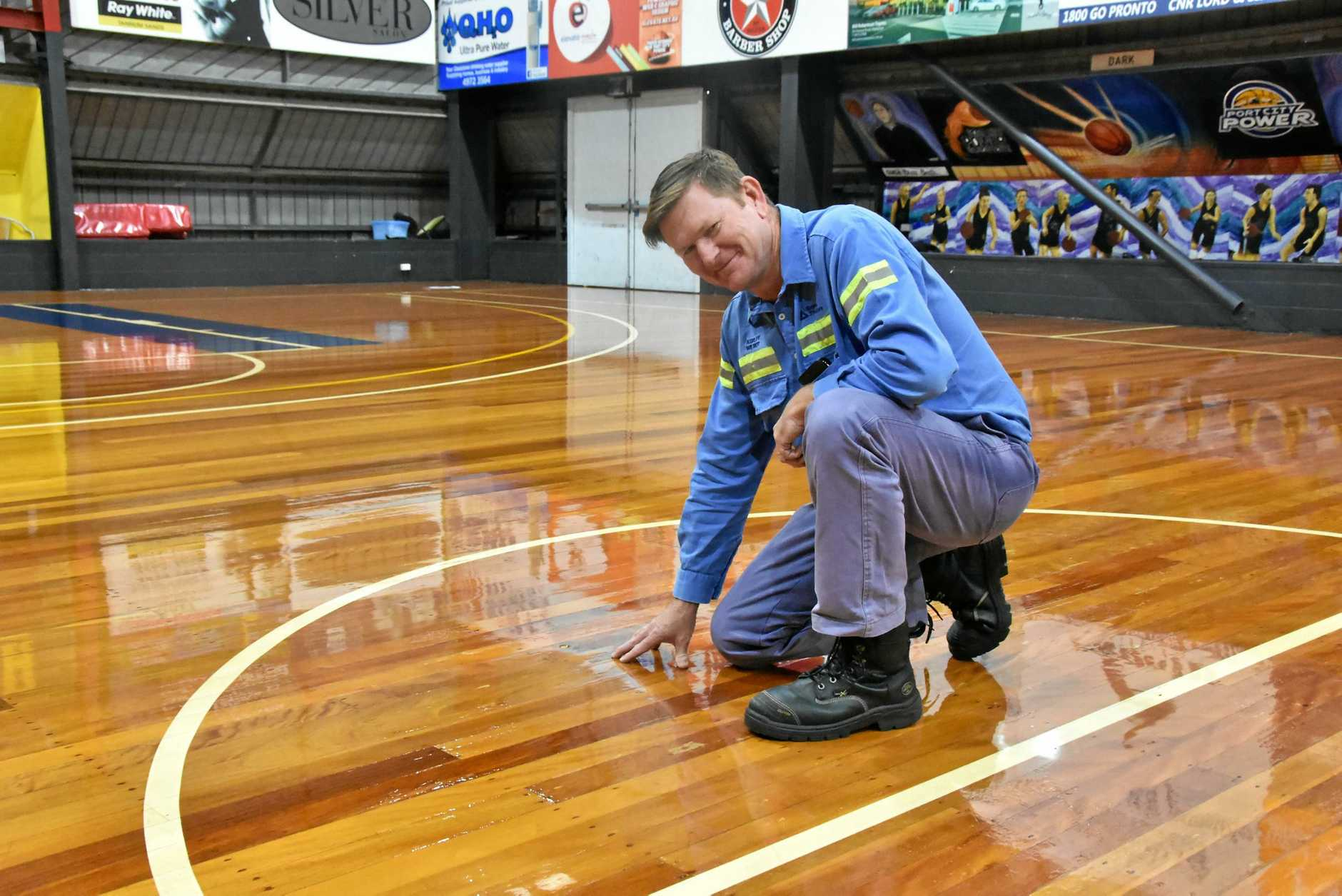 NEW COAT: Gladstone Amateur Basketball Association president Ashley Wilmot checks out the freshly resurfaced Kev Broome Stadium