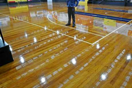 Gladstone Amateur Basketball Association president Ashley Wilmot checks out the freshly resurfaced Kev Broome Stadium floor.