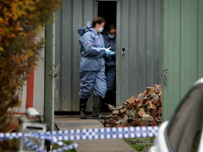 Police collect finger prints and conduct a search of the Broadmeadows home. Picture: Stuart McEvoy