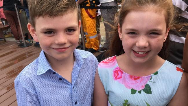 Gold Coasters Patrick, 8, and Annie, 10, Riley made the Royal couple Anzac biscuits and presented Prince Charles and Camilla with a bunch of flowers. Pic: Kathleen Skene