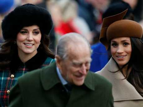Duke of Edinburgh and Kate Middleton and Meghan Markle. Picture: AFP