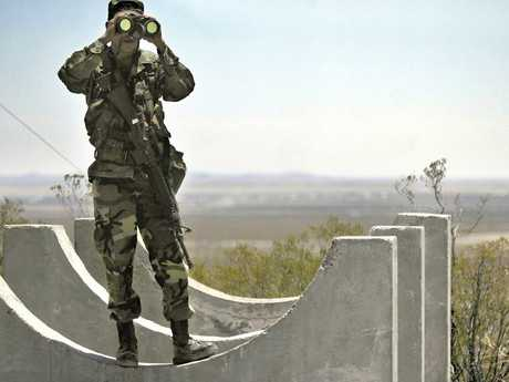 Army National Guard Gustavo Gutierrez scans the US/Mexico border from the top of Radar Hill, near Columbus, New Mexico in 2006. Picture: AP
