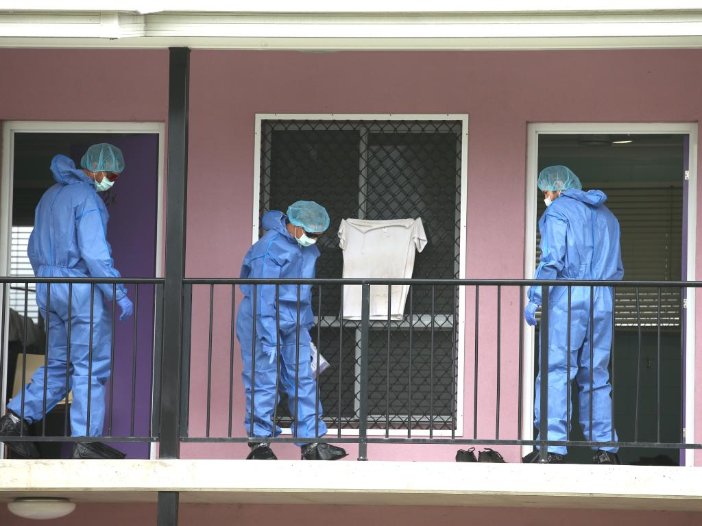 Police forensic officers investigate outside the rooms where the stabbings took place, the day after Mia Ayliffe-Chung was stabbed to death. Picture: Lyndon Mechielsen/The Australian