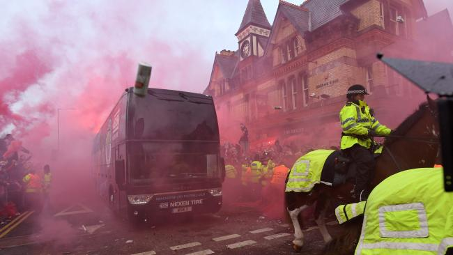 Bottles and cans are thrown at the bus as Manchester City arrive