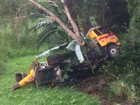 A cement truck crashed down an embankment in Buderim, narrowly missing three homes.