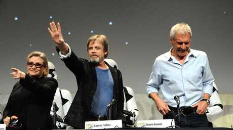 Carrie Fisher, Mark Hamill, and Harrison Ford attend Lucasfilm's Star Wars: The Force Awakens panel on day 2 of Comic-Con International on Friday, July 10, 2015, in San Diego, Calif.