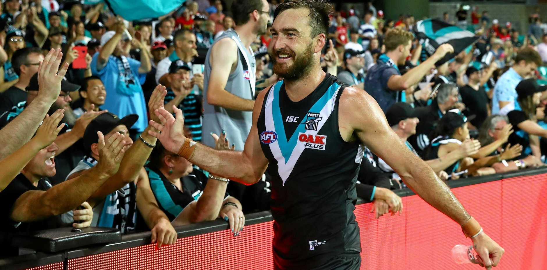 Charlie Dixon with Port Adelaide fans after winning the round two clash with the round two win over the Sydney Swans.