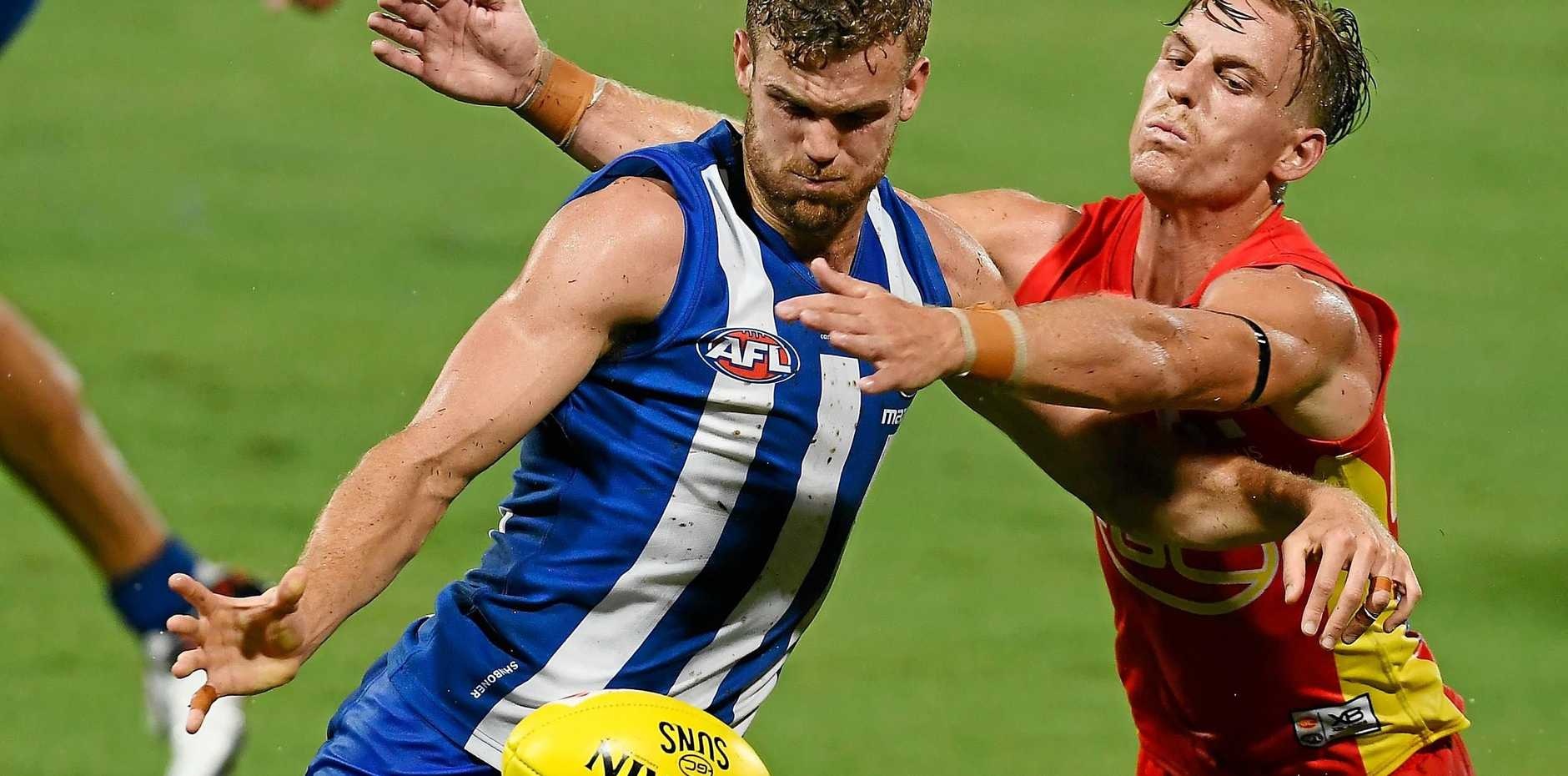Darcy Macpherson tackles the Kangaroos' Ed Vickers-Willis in round one.