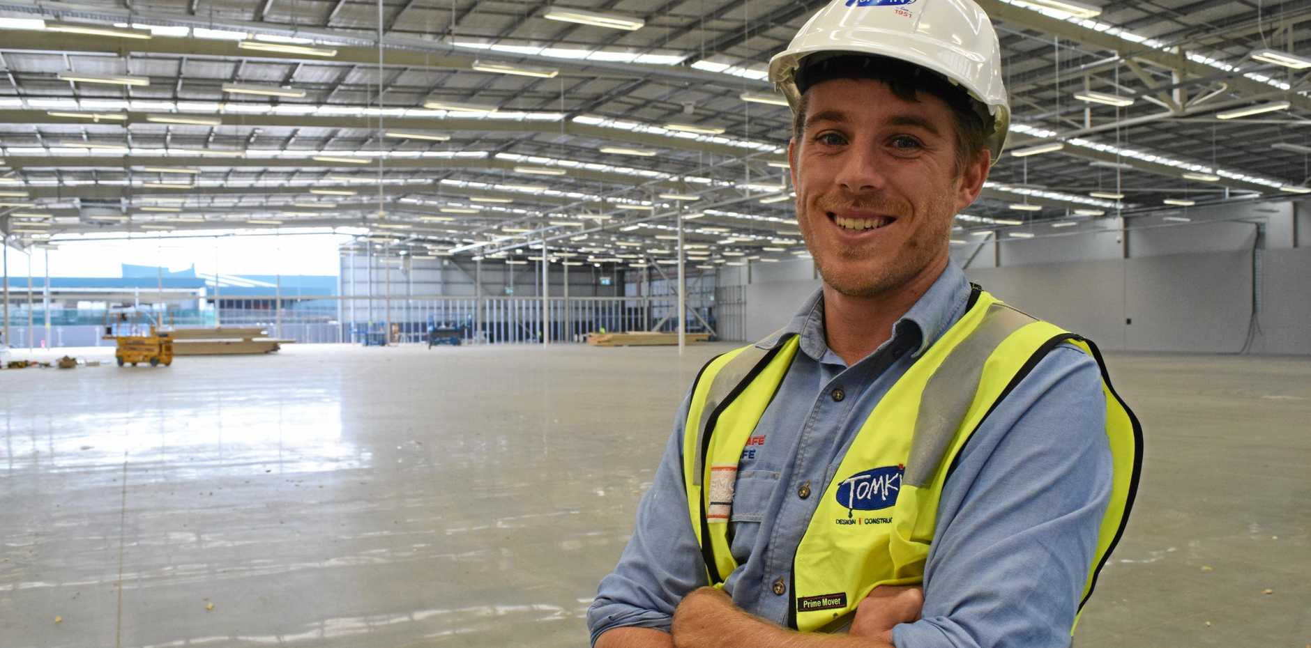 Tomkins site manager Tyler Krinks stands inside what is to become Lismore newest shopping centre.