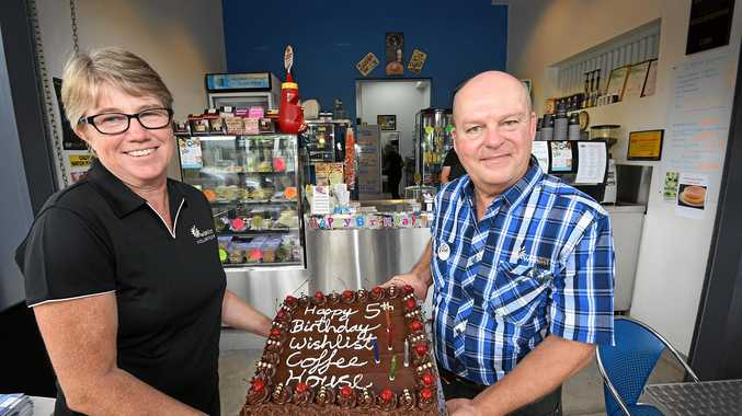 PROUD: Wishlist Coffee House 2IC Leah Pearson (left) and manager Richard Ward celebrate the cafe's fifth birthday.