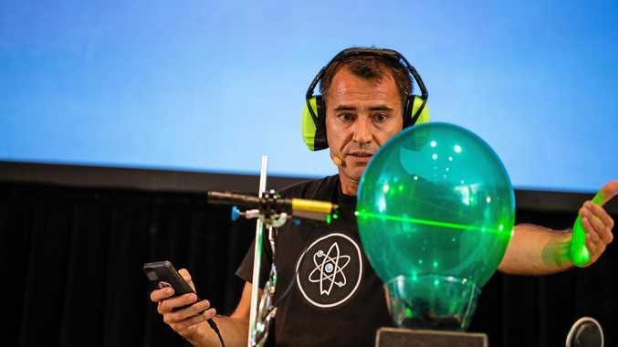 LIKE MAGIC: Ruben Meerman, uses a green laser beam to pop a red balloon that's on the inside of the green balloon.