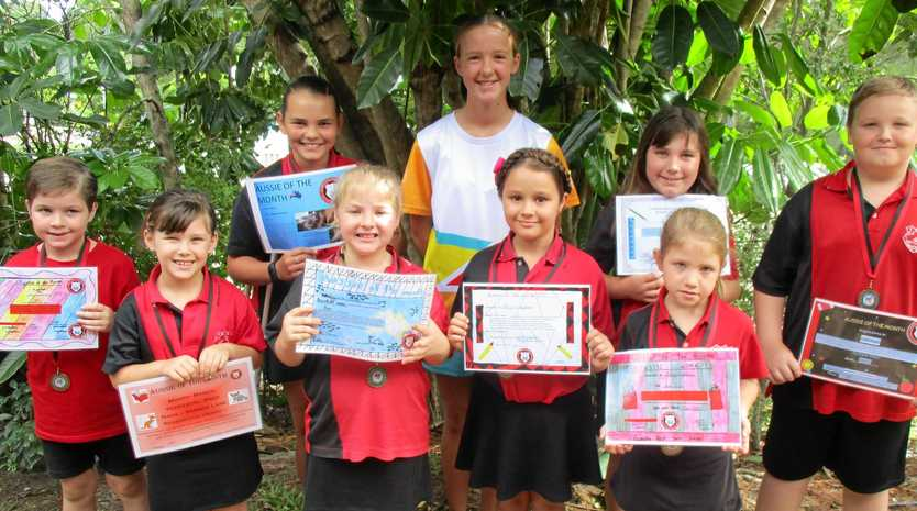 SCHOOL'S FINEST: Aussies of the Month at Gympie West for March were: (Back from left) Madison Belsham, Awards presenter Isabelle Cantle, Emily Helfer and Luke Ford and (Front from left) Kai Wilkins, Summer Lane, Laila Sorensen, Jorgia Creighton and Abby Rogers.
