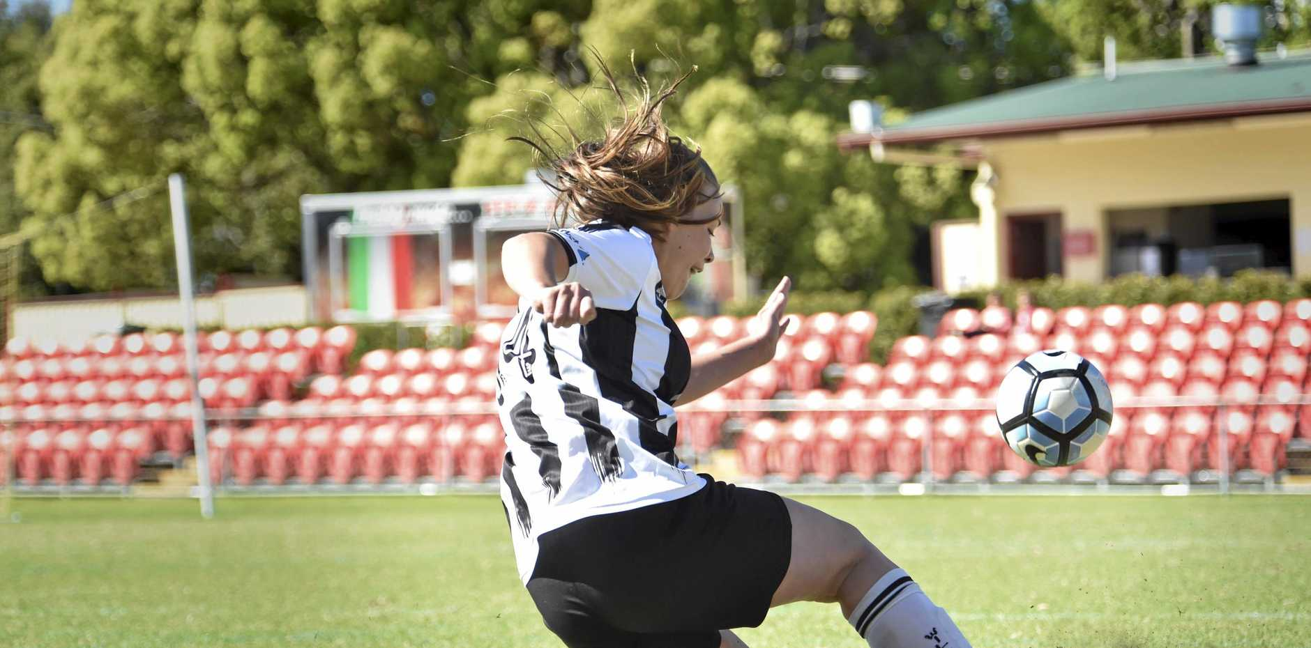 GOOD DEFENCE: Nicole Mairs clears the ball for Willowburn during a match last year.