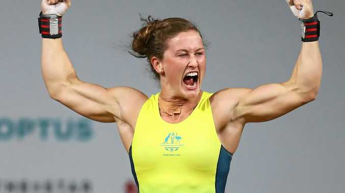CHAMPION: Tia-Clair Toomey of Australia celebrates her gold winning lift in the clean and jerk during the Women's Weightlifting 58kg.
