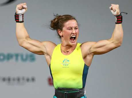 GOLD COAST, AUSTRALIA - APRIL 06:  Tia-Clair Toomey of Australia celebrates her gold winning lift in the clean and jerk during the Women's Weightlifting 58kg on day two of the Gold Coast 2018 Commonwealth Games at Carrara Sports and Leisure Centre on April 6, 2018 on the Gold Coast, Australia.  (Photo by Michael Steele/Getty Images)