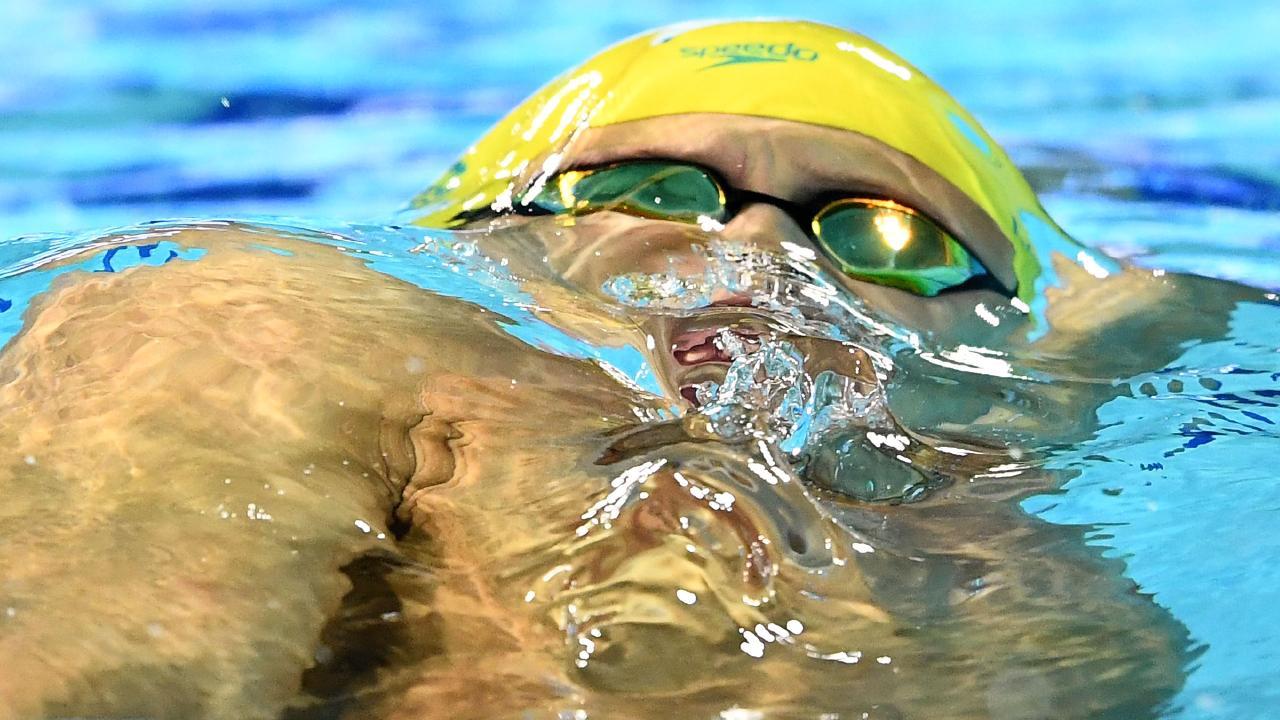 Mitch Larkin competing in the 100m backstroke final.