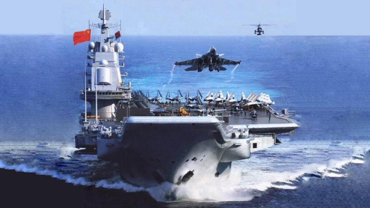 The Chinese aircraft carrier Liaoning launches one of its jet fighters as a rescue helicopter watches on. The carrier is leading major military exercises in the South China Sea