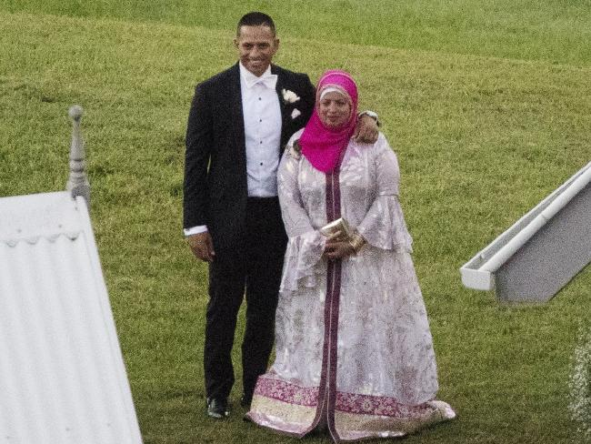 Usman Khawaja and a family member pose for photos. Picture: Lachie Millard