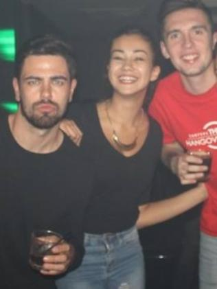 Mia, second left, with fellow Brit Chris Porter (third from left) socialising with partygoers on the Gold Coast in Surfers Paradise before their fateful trip to Home Hill in North Queensland in August where Miss Ayliffe Chung was stabbed to death during the night at their hostel.