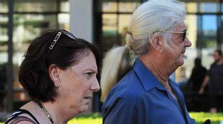 Travis Davis's parents, Sue-Anne Davis and Warren Davis, leave Cairns Courthouse after William Darcy Reid is found guilty of Davis' murder. PICTURE: BRENDAN RADKE