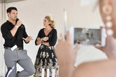 Bachelorette star Apollo Jackson is interviewed by Fashions on the Field compere Maree Parsons on Weetwood day at Clifford Park Racecourse, Saturday, April 7, 2018.