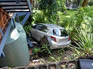 Couple crashes down steep driveway embankment