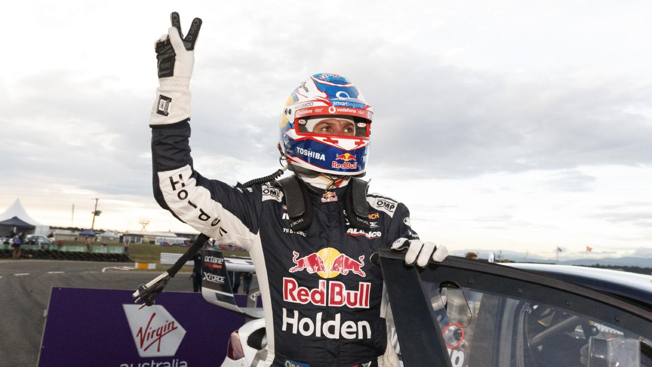 Jamie Whincup celebrates winning race one.