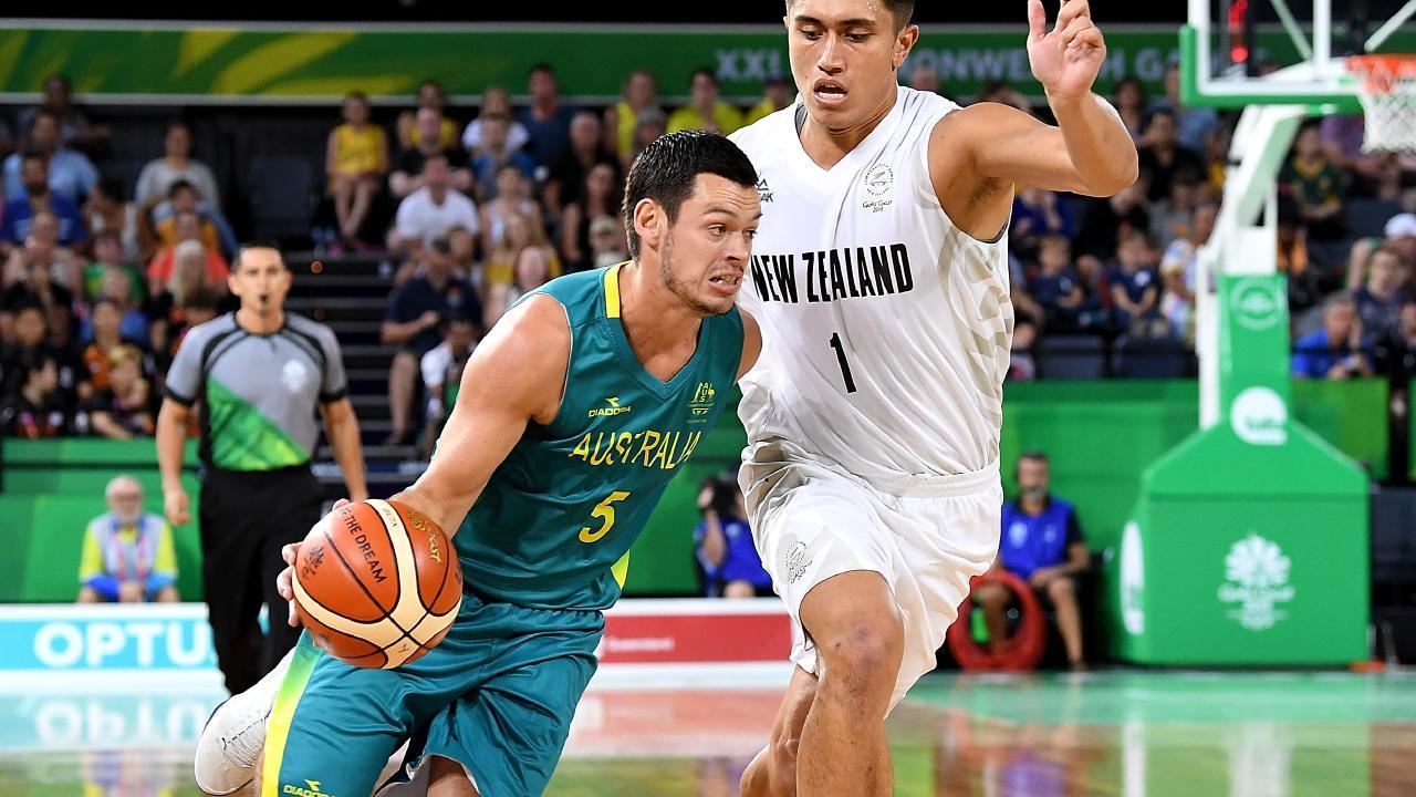 Jason Cadee of Australia takes on the defence of Reuben Te Rangi of New Zealand on Saturday night.