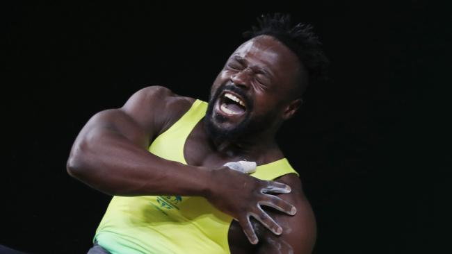 Australia's Francois Etoundi tore his bicep on his way to winning a bronze medal.