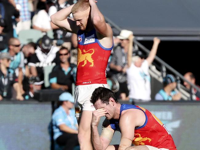 Nick Robertson and Darcy Gardiner feel the pain of the Lions' close loss. Picture: SARAH REED