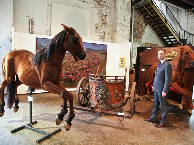 John Keats from Sotheby's Australia stands with props from the film Gladiator owned by actor Russell Crowe. Picture: AAP