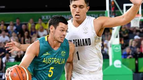 Australia's Jason Cadee looks to get past New Zealand's Reuben Te Rangi on Saturday night.