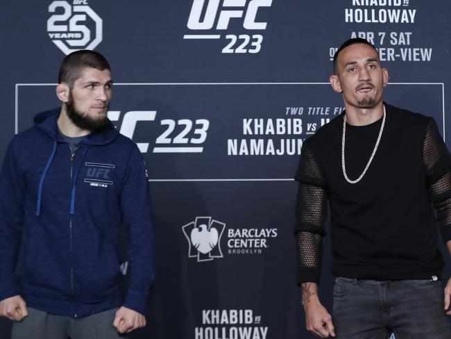 Khabib Nurmamogedov, left, glances at UFC opponent and featherweight champion Max Holloway.