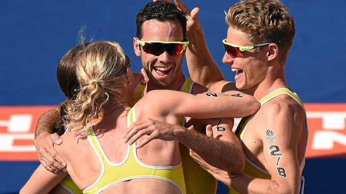 GOLD COAST, AUSTRALIA - APRIL 07:  Jacob Birtwhistle of Australia celebrates with team mates Matthew Hauser, Gillian Backhouse and Ashleigh Gentle after winning Gold in the Triathlon Mixed Team Relay on day three of the Gold Coast 2018 Commonwealth Games at Southport Broadwater Parklands on April 7, 2018 on the Gold Coast, Australia.  (Photo by Matt Roberts/Getty Images)